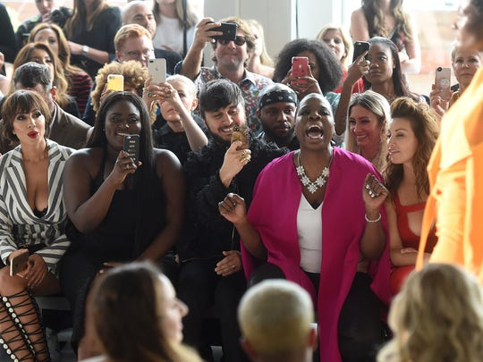Leslie Jones cheers at the Spring/Summer 2018 Christian