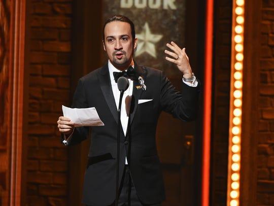 Songwriter Lin-Manuel Miranda accepts the award for