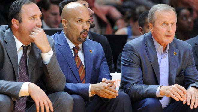 Tennessee assistant coach Chris Ogden, Tennessee associate head coach Rob Lanier, and Tennessee head coach Rick Barnes watch from the sideline during the second half against UNC Asheville at Thompson-Boling Arena on Friday, Nov. 13, 2015. (ADAM LAU/NEWS SENTINEL)
