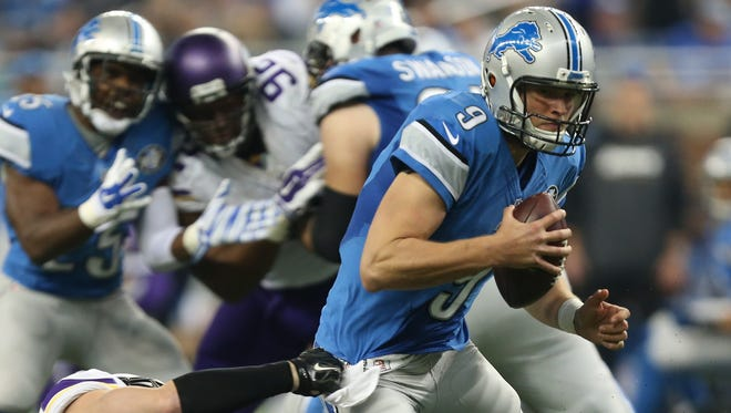 Detroit Lions Matthew Stafford is sacked by  Minnesota Vikings Harrison Smith during first half action.