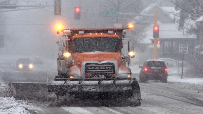 A snowplow clears a section of Veterans Drive on Friday, Nov. 18,  in St. Cloud.