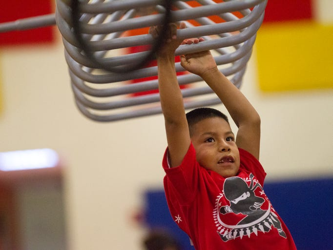 Wesley Atcitty, 6, traverses his way across an obstacle