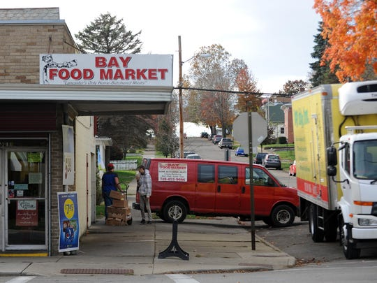 Bay Food Market employees receive a shipment outside the store Friday, Nov. 11, 2016, at the corner of East Walnut and South Maple streets in Lancaster. Despite rumors since the announced closing of Carnival Foods Bay Food Market is not closing.