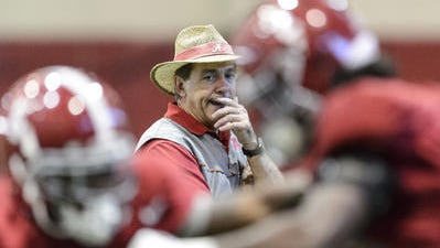 Alabama head coach Nick Saban observes players.