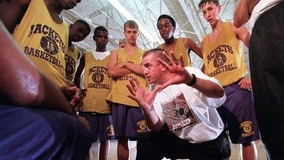 Current LSUS athletic director Chad McDowell, shown here coaching Byrd in 2000, will soon be the Calvary superintendent.