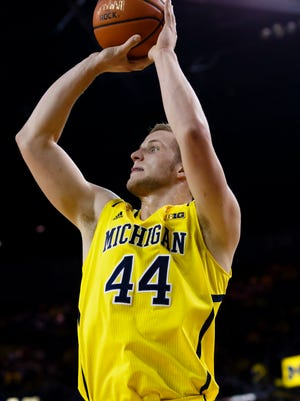 Michigan Wolverines forward Max Bielfeldt (44) shoots in the first half against the Rutgers Scarlet Knights at Crisler Center.