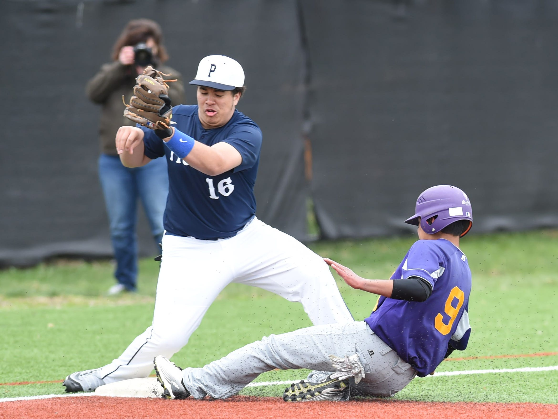 Poughkeepsie's third baseman, Steven Disla, covers Rhinebeck's Jesse Schneyer during Saturday's game at Poughkeepsie High School.