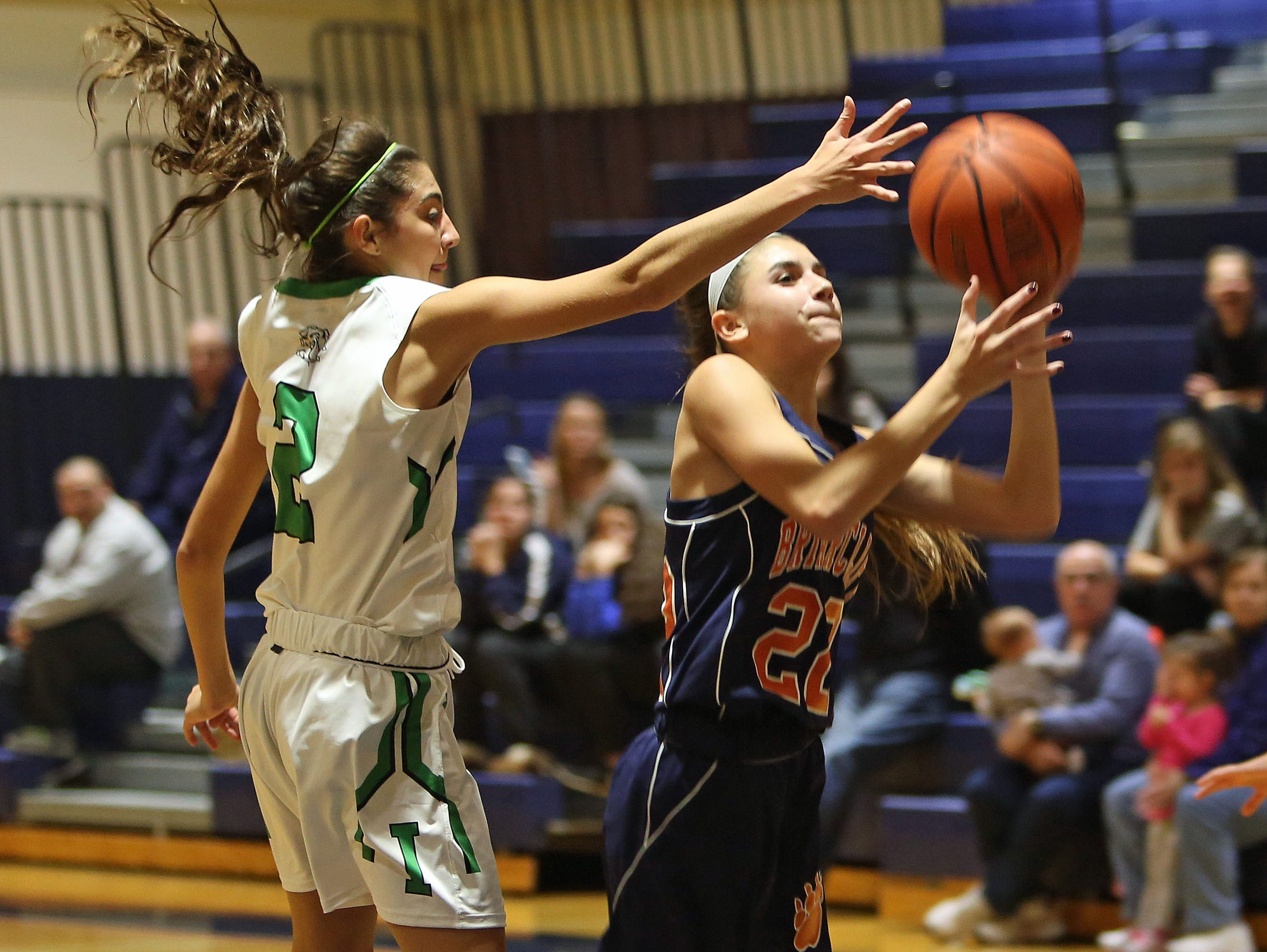 From left, Irvington's Olivia Valdes (2) puts pressure on Briarcliff's Mia Persico (22) during girls basketball action at Briarcliff High School Dec. 1, 2015. Irvington won the game 71-57.