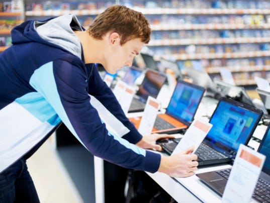 buying a laptop stock photo