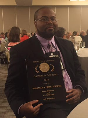Kevin Robinson with his award.