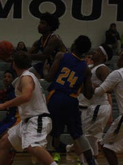 Redford Union's Eric McCarter eyes the basket after