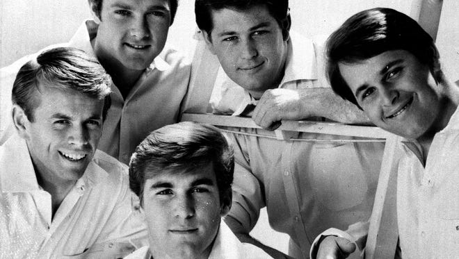The Beach Boys lineup from around 1965 included three brothers, a cousin and a friend. They were Al Jardine, from left, Mike Love, Dennis Wilson, Brian Wilson and Carl Wilson.