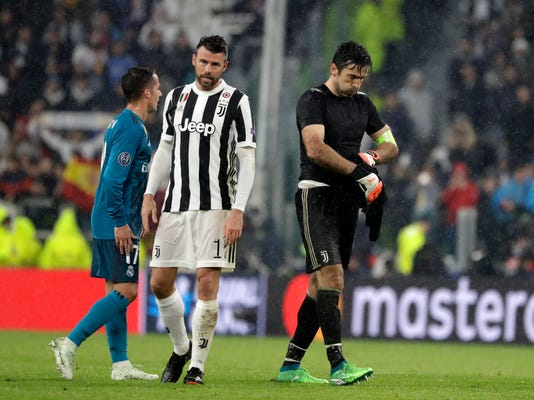Juventus' Andrea Barzagli, left, and goalkeeper Gianluigi Buffon react after the Champions League, round of 8, first-leg soccer match between Juventus and Real Madrid at the Allianz stadium in Turin, Italy, Tuesday, April 3, 2018. Real won 3-0. (AP Photo/Luca Bruno)