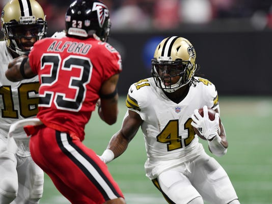 File-This Dec. 7, 2017, file photo shows New Orleans Saints running back Alvin Kamara (41) running near Atlanta Falcons cornerback Robert Alford (23) during the first half of an NFL football game in Atlanta.  Kamara and several other recently injured Saints returned to practice Wednesday, Dec. 13, 2017, providing New Orleans hope of getting back several offensive and defensive regulars as they try to maintain their slim lead atop the NFC South.  (AP Photo/Danny Karnik, File)