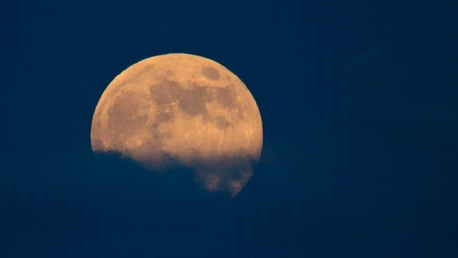 A super moon rises over the Boynton Beach Inlet in Boynton Beach, Florida on September 8, 2014.