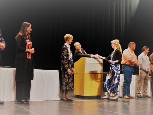 Ruidoso school district officials congratulate students being honored at Second Annual 'High 5' celebration of excellence at the Spencer Theater Wednesday, Oct. 11.