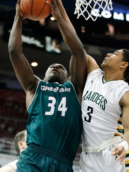 Green Bay's Charles Cooper (34) goes to the basket against Wright State's Mark Hughes (3) during the first half of an NCAA college basketball game for the Horizon League men's tournament championship, Tuesday, March 8, 2016, in Detroit. (AP Photo/Duane Burleson)