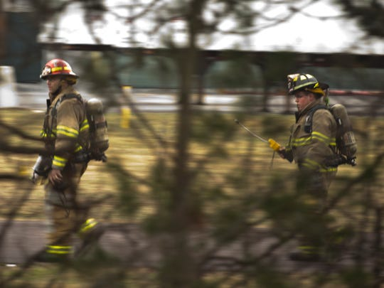 Milton firefighters monitor gas levels around an NG Advantage trailer on Gonyeau Road in Milton on Saturday morning. The leak prompted the evacuation of the area a few hundred feet from Interstate 89.