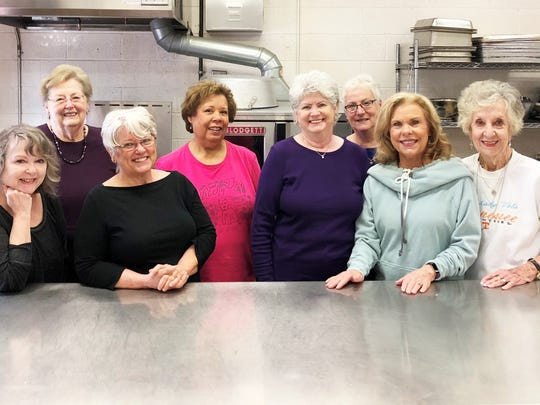 Before the Martha's Kitchen volunteers leave to make deliveries, they gather in the Church of the Good Shepherd's kitchen. From left: Nan Harless, Nancy Griffith, Melinda Davis, Cheryl Snell, Sue Kluck, Roz Yenzer, Janice Wade and Mary Lou Jones.