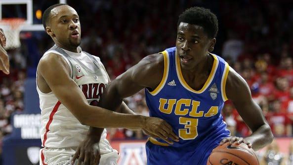 UCLA guard Aaron Holiday (3) drives past Arizona guard