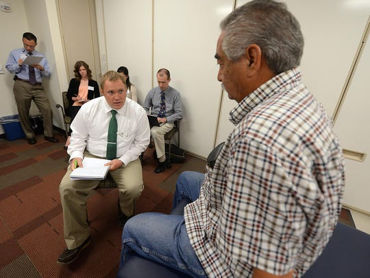 Medical College of Wisconsin-Green Bay student Philip Kostka, center, practices patient interviewing and history gathering.