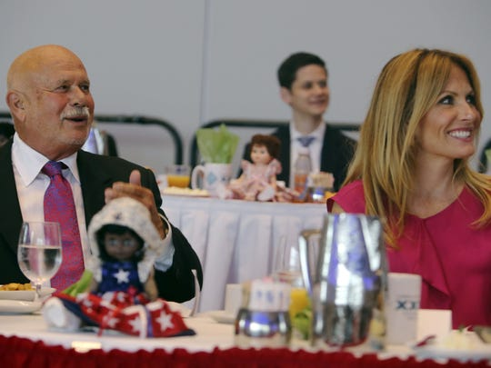 Goodfellows honors Peter Karmanos, Jr.  as their 2013 Goodfellow of the Year award recipient during their 24th annual tribute breakfast held at Cobo Center Fri., Sept., 20, 2013 in Detroit. He is seated on the dais with his wife Danialle Karmanos.