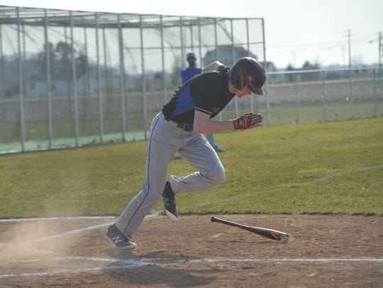 Wyatt Smith races toward first base after a hit.