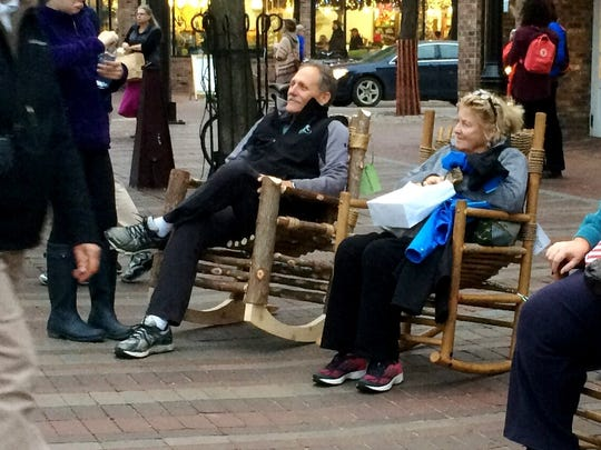 Doug Best, left, of Martha's Vineyard and Cindy McNahon of Montreal, bask in rocking chairs late Friday afternoon on Church Street in Burlington.