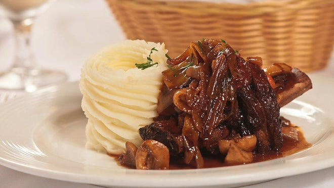 Locally acclaimed for such dishes as beef short ribs with Bourguignon sauce, Chez Jean-Pierre, 132 N. County Road, is set to reopen Tuesday.