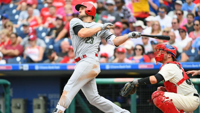 Cincinnati Reds left fielder Adam Duvall (23) watches his two-run home run during the fifth inning against the Philadelphia Phillies today at Citizens Bank Park.