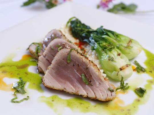 Cashew-Crusted Ahi Tuna With Mint-Basil Oil, Bok Choi With Roasted Garlic Grapeseed Oil and Ginger Risotto With Coconut-Citrus Oil from the Arizona Culinary Institute in Scottsdale, Ariz.