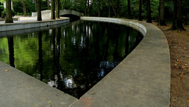 A pool reflects the verdant scenery at Theodore Roosevelt Island in Washington, D.C.