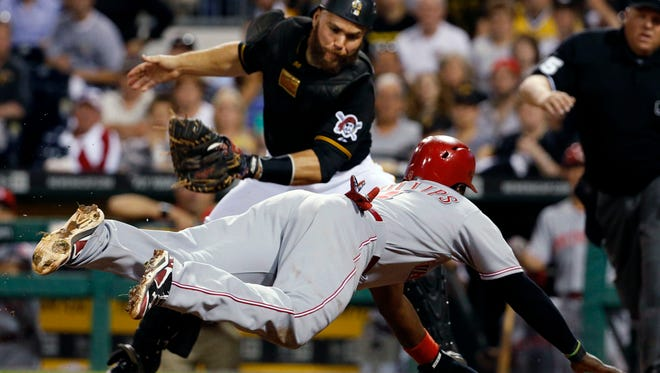 Pittsburgh Pirates catcher Russell Martin prepares to make the sweep tag on Cincinnati Reds' Brandon Phillips for the final out of the eighth inning.