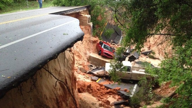 Scenic Highway collapsed at the 3800 block of the road during the flooding on April 30, 2014. Two vehicles plummeted about 40 feet down the bluffs and into a ravine. The flood-damaged areas of Scenic Highway now are expected to reopen for traffic in mid-July, according to the Florida Department of Transportation.