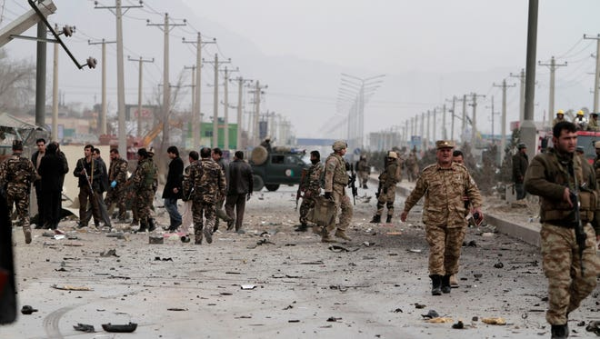 Afghan police and U.S. forces respond to a suicide car bomb attack in Kabul on Dec. 27.