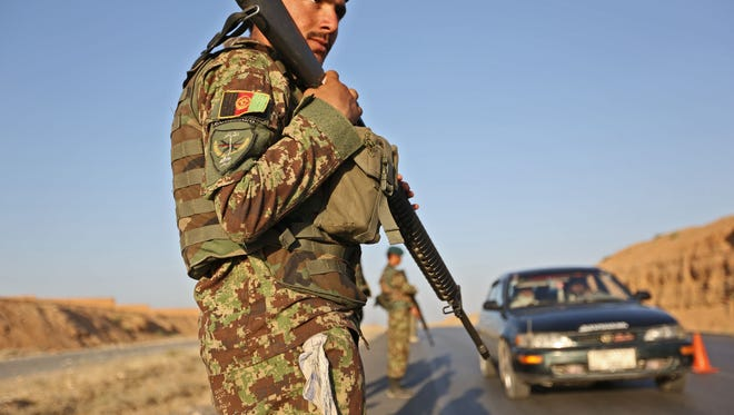 Afghan army forces guard checkpoint outside Jalalabad.