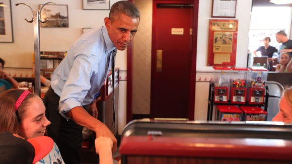 President Barack Obama stops at Charcoal Pit on Concord Pike for lunch Thursday.