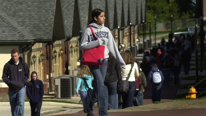 Betsy Varghese makes her way back to her dorm from class at SUNY Geneseo. File photo.