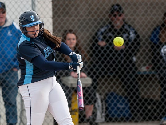 Richmond's Erin Shuboy hits a double during the first