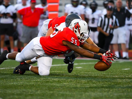 Colerain defensive lineman Tre Harris dives on a fumble