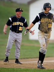 Jasper coach Terry Gobert argues the umpire's call after his player, Evan Aders, was called out on the front end of a double-steal in the top of the third inning against Central Monday evening.