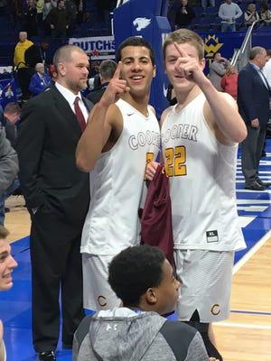 Cooper seniors Dante Hendrix and Sean McNeil celebrate after their win Saturday night.