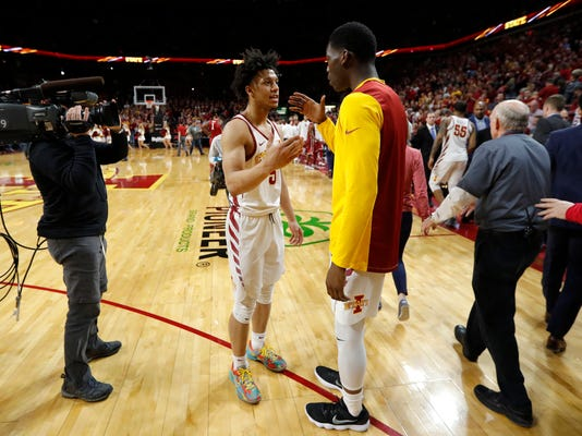 Iowa State guard Lindell Wigginton celebrates teammate Terrence Lewis, right, at the end of an NCAA college basketball game against Oklahoma, Saturday, Feb. 10, 2018, in Ames, Iowa. Iowa State won 88-80. (AP Photo/Charlie Neibergall)
