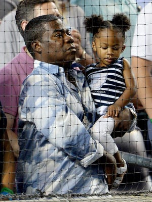 Tracy Morgan holds his daughter Maven Sonae during the game between the Boston Red Sox and the New York Yankees at Yankees Stadium in the Bronx.