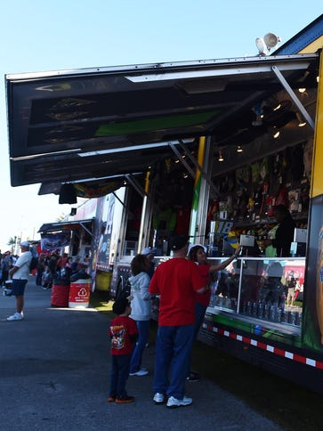 Fans peruse items at the merchandise trailer for  Kyle