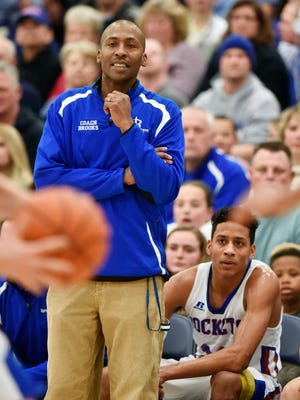 Spring Grove head coach James Brooks and son Eli, bottom right, watch the second half of a first-round PIAA Class AAAA boys' basketball game March 5, 2016 at West York High School.