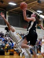 Delone Catholic's Maddie Clabaugh shoots against York Catholic's Jania Wright in the second half of a YAIAA girls basketball game Wednesday, Jan. 4, 2017, at York Catholic. After earning its first lead over Delone Catholic late in the fourth quarter, York Catholic won 67-62.