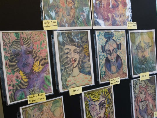 An array of artist Nyle Rosenbaum's prints for sale for the 2015 Spring into the Arts on Friday.