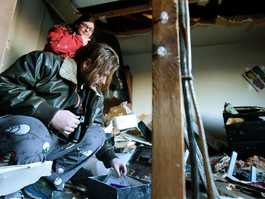Austin Kling, 21, finds an intact safe box while surveying