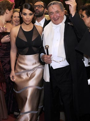 Kardashian and her host, Austrian businessman Richard Lugner, arrive for the Vienna Opera Ball in Vienna, Austria on Feb. 27, 2014. At the event, she was accosted by a man in blackface.